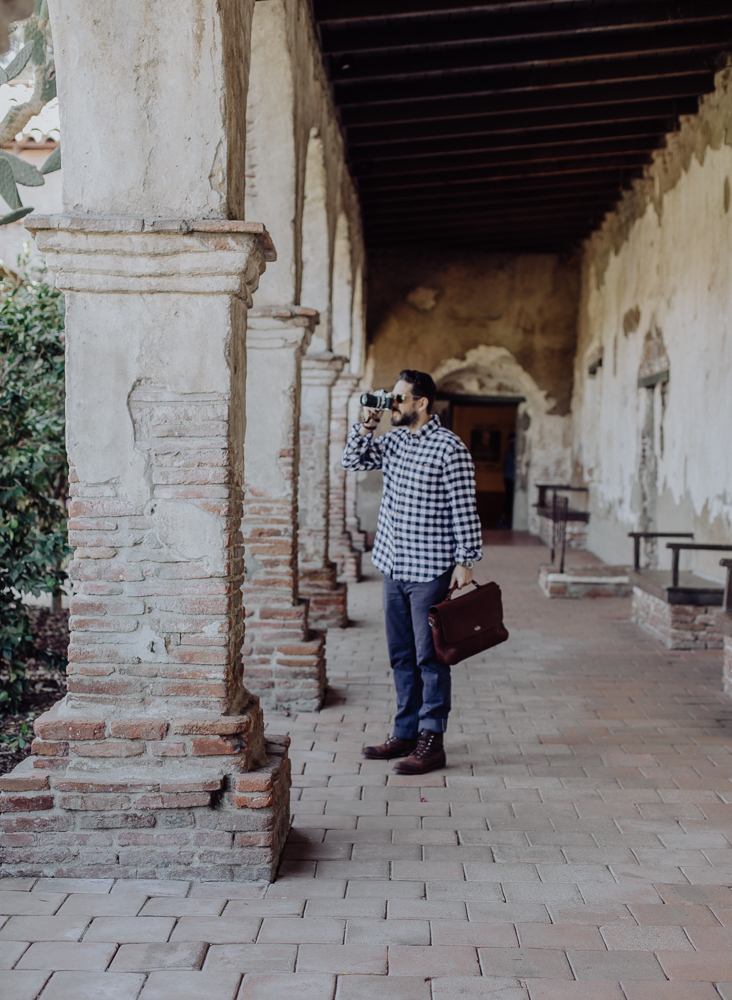 Lifestyle blogger Devin McGovern of Outlined Cloth features Buffalo Jackson messenger bag taking film photos