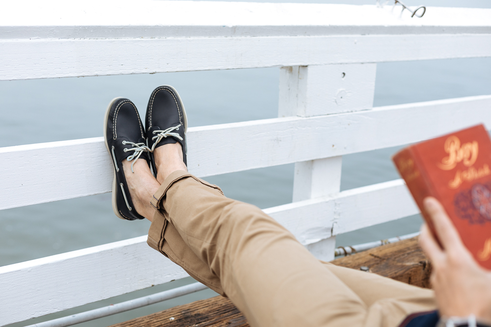 Lifestyle blogger Devin McGovern of Outlined Cloth takes a stroll in Malibu in original Sperry boat shoes