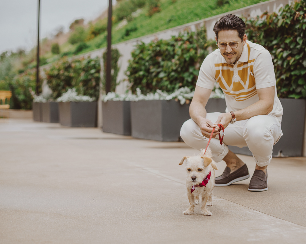 Lifestyle blogger Devin McGovern of Outlined Cloth takes a stroll in Malibu with a puppy and the Kennedy Loafers from Sperry